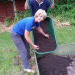 phil wheelbarrowing in the top soil